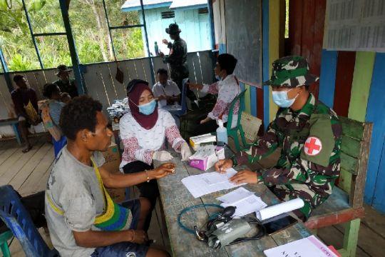 Satgas TNI berikan layanan kesehatan posyandu warga perbatasan RI-PNG