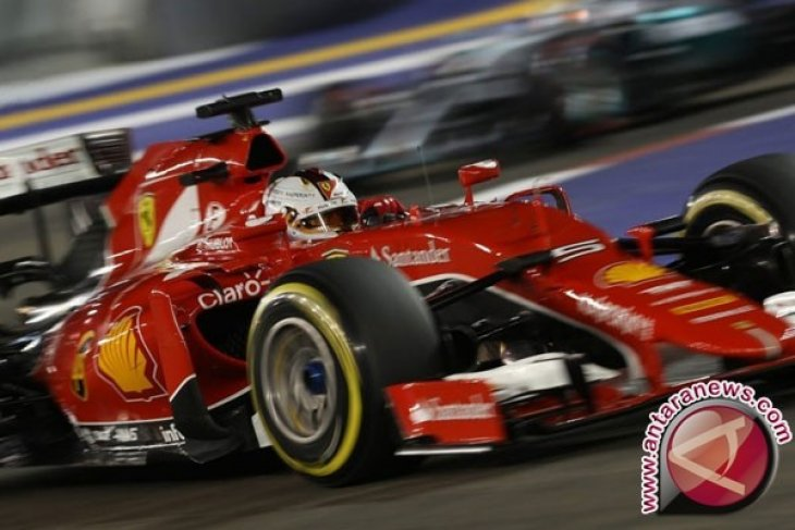 Pebalap Ferrari Vettel start pertama GP China