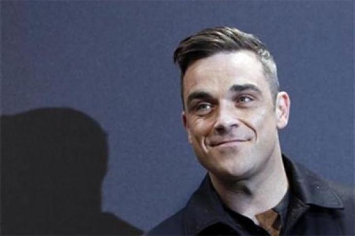 Jadi pembuka Piala Dunia, Robbie Williams dilarang nyanyikan lagu ini