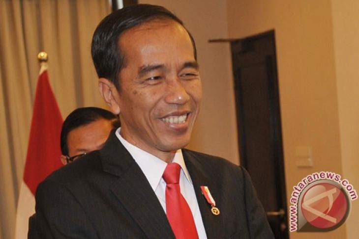 President Jokowi arrives in Iran