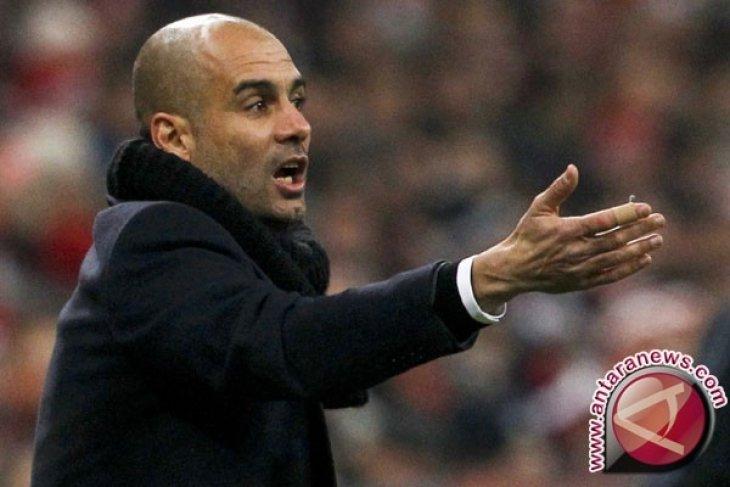 Guardiola bersikeras perburuan gelar masih ketat