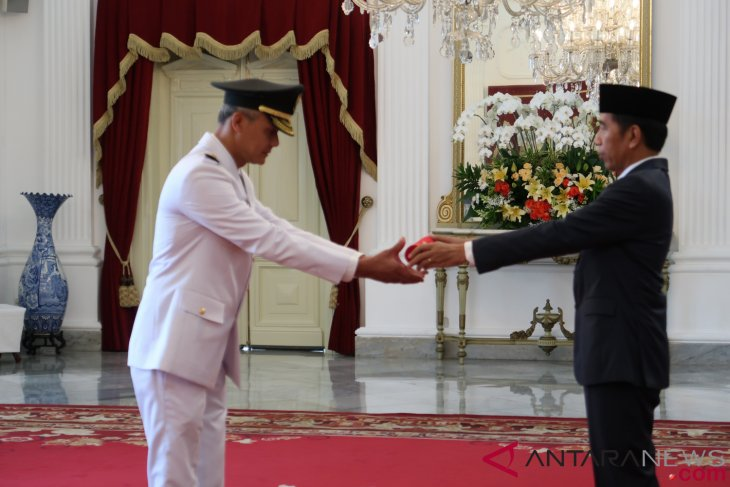 President Jokowi installs nine governors
