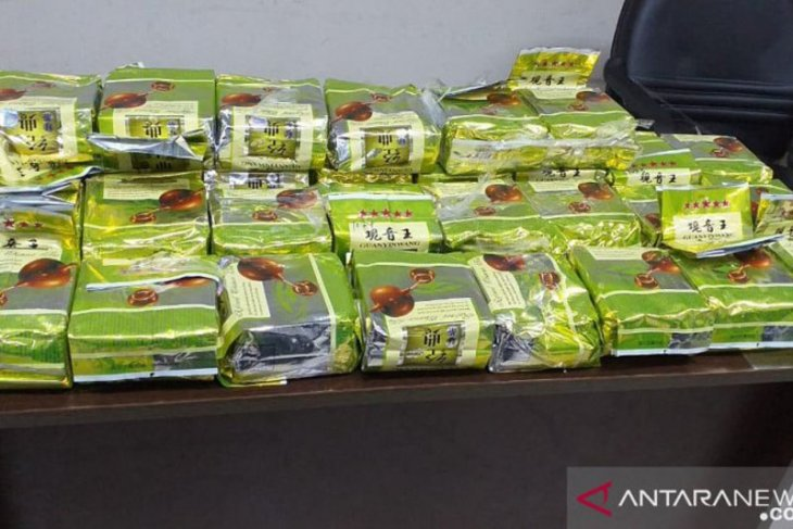 BNN confiscates 52 kg crystal meth in Chinese tea packs from Malaysia