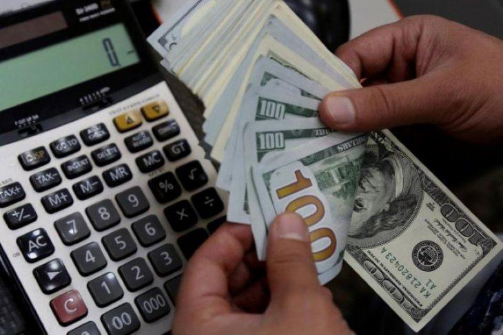 Dolar jatuh setelah Bank Sentral AS pertahankan tahan suku bunga