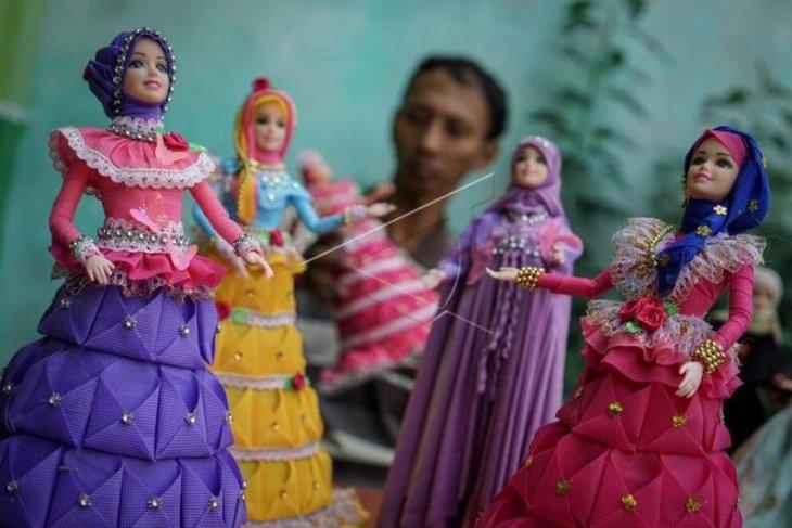 Produksi busana muslim untuk boneka barbie