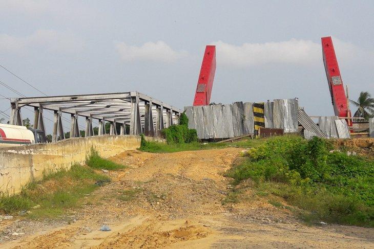 Jelang Hari Raya pembangunan jembatan Sei Wampu belum juga rampung
