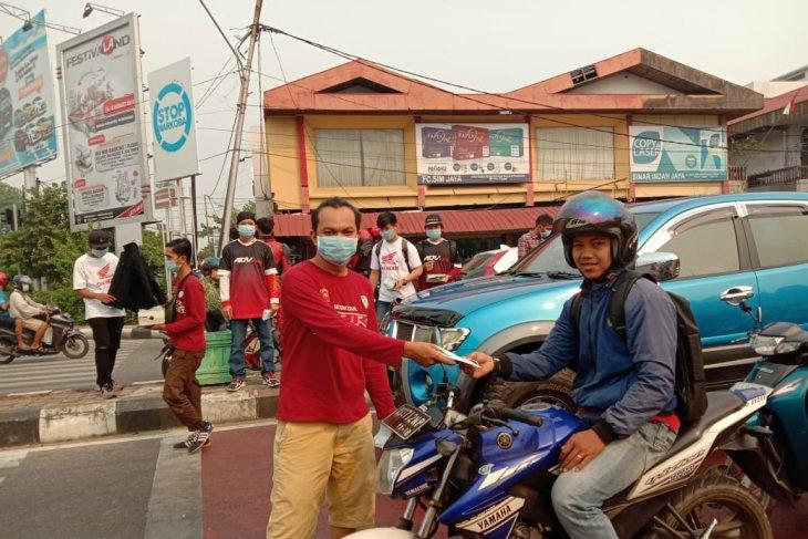 Kabut asap, HCI bagikan masker untuk pengendara