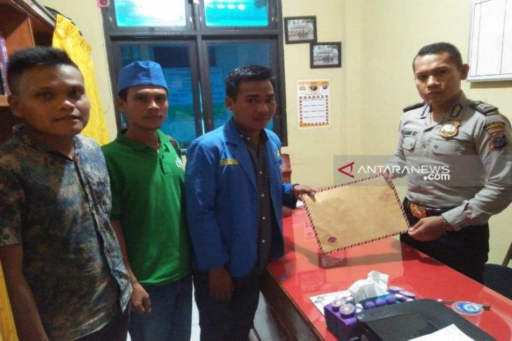 PMII Madina laporkan pelaksanaan Bimtek Aparatur Desa ke Polisi