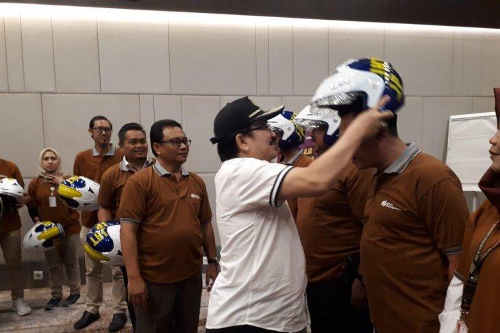 Tekan kecelakaan di jalan, BPJS-TK Banten bagikan 500 helm