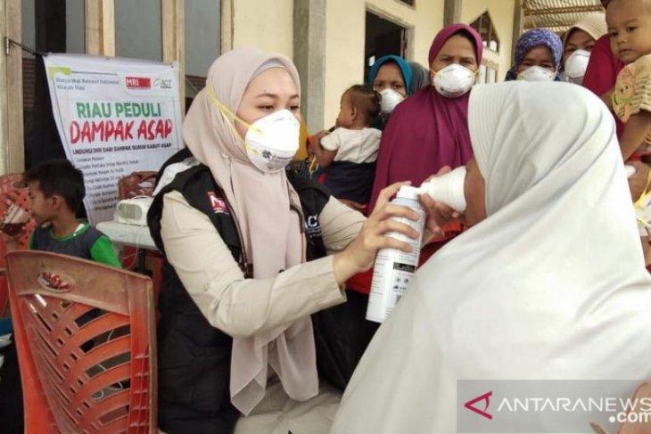 Ribuan masker dibagikan pada warga terdampak kabut asap