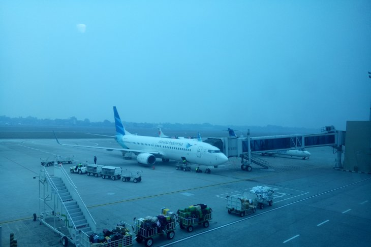 Saat akan mendarat, empat pesawat berputar-putar akibat kabut asap selimuti palembang