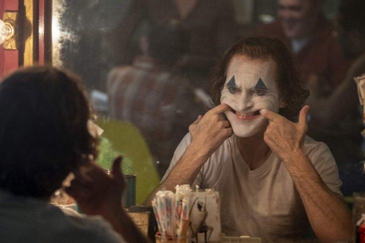 Di balik tata rias wajah Joker
