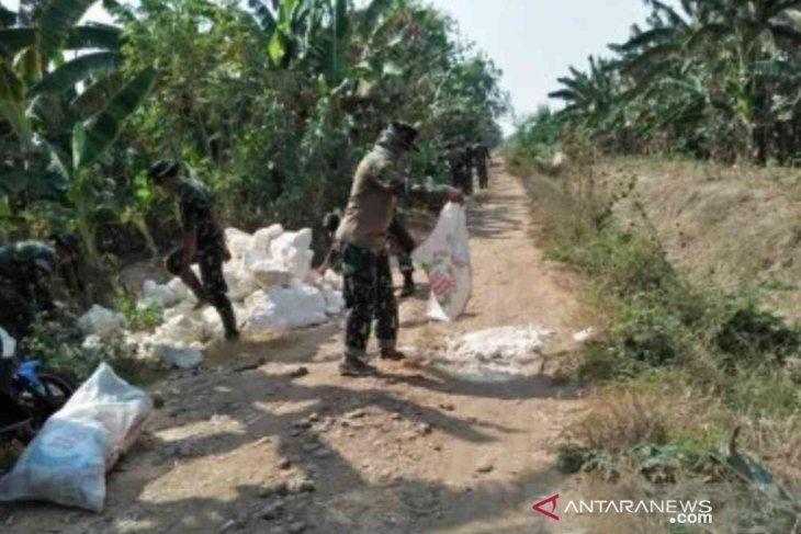 HUT ke-74 TNI, Kodim 0509 Bekasi isi dengan bangun desa