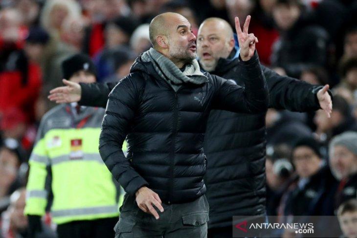 Pep Guardiola menegaskan timnya tampil layaknya juara bertahan kendati kalah