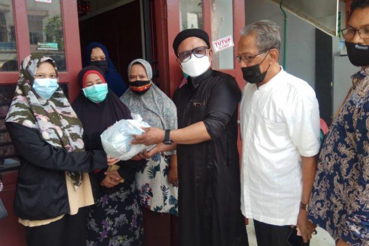 Ringankan beban masyarakat, PLN Aceh bagi bingkisan untuk  Anak Yatim dan Fakir Miskin thumbnail