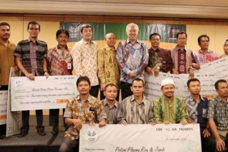 Asian Agri Membagikan Hasil Penjualan Minyak Sawit Berkelanjutan kepada 29.000 Petani