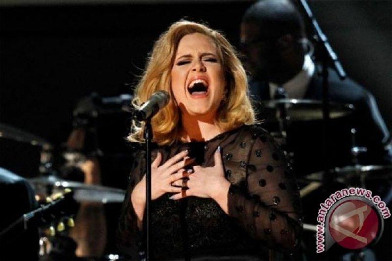 Terinspirasi dari perceraian, Adele kembali bermusik
