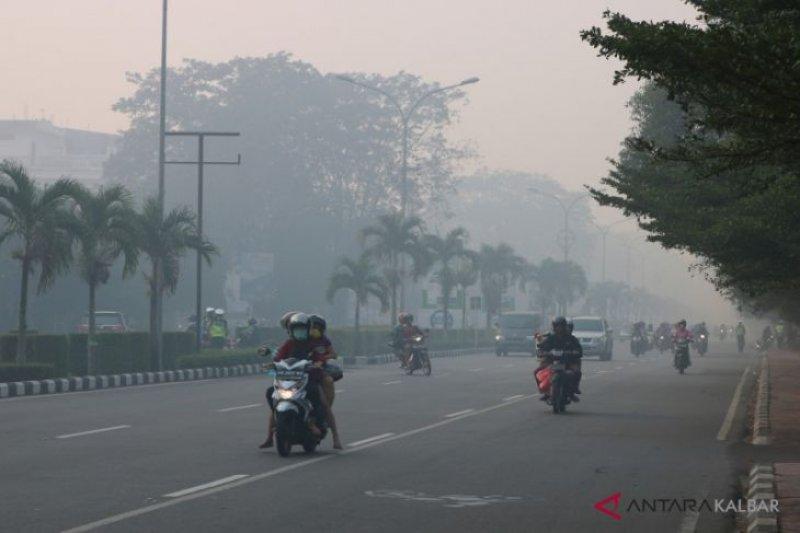 Mencoba berdamai dengan kabut asap