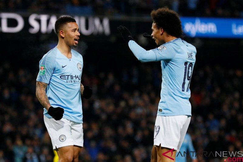 Gelar pesta sembilan gol ke gawang Burton, Manchester City satu kaki di final