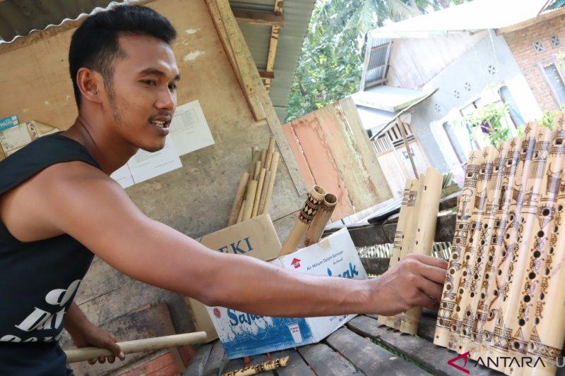 Ini dia alat musik tiup Minang berukir Tabuik Pariaman yang mulai laris di pasaran (Video)