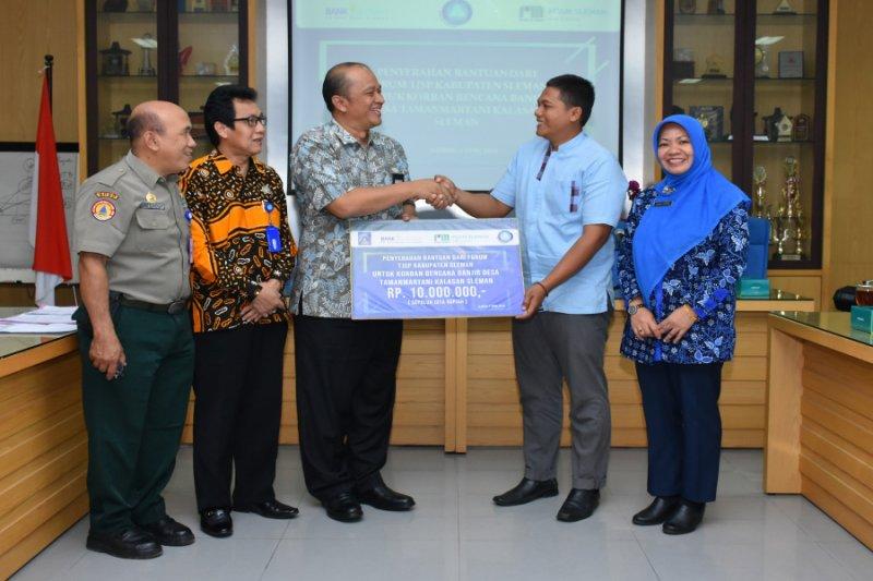 Forum TJSP Sleman menyerahkan bantuan bencana untuk desa terdampak banjir