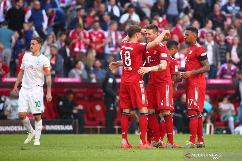 Munchen  gilas Dusseldorf empat gol tanpa balas