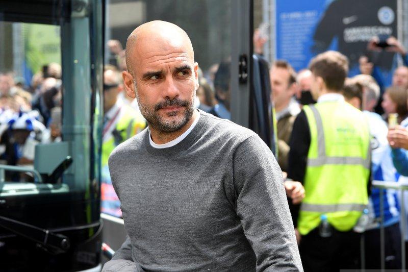Guardiola tegaskan tekadnya untuk pertahankan Sane