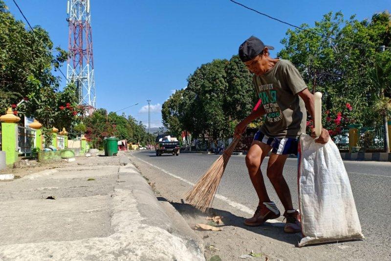 Tuna daksa tidak halangi Usman membersihkan jalanan