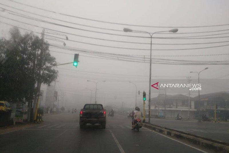 Di Pontianak murid TK dan siswa SD terpaksa diliburkan gara-gara kabut asap