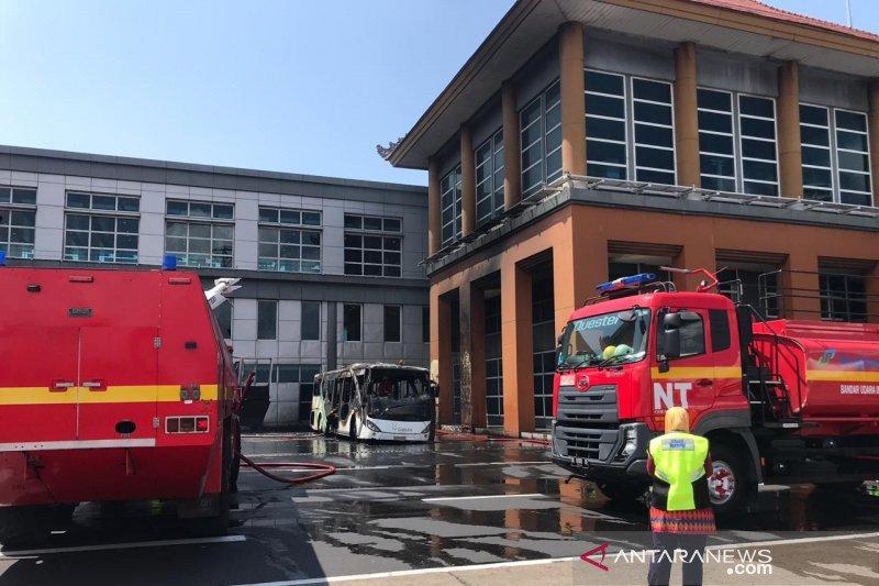 Satu unit bus terbakar  di apron Bandara Ngurah Rai