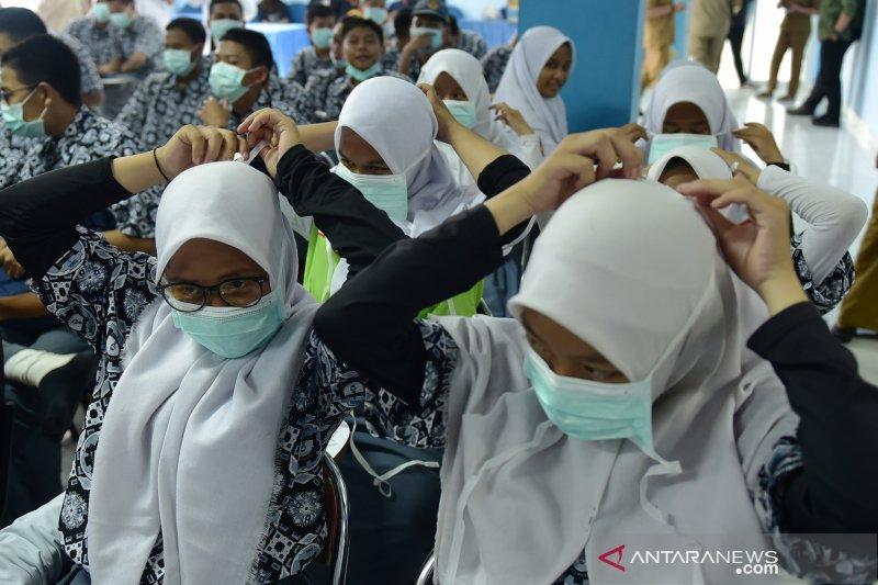Akibat kabut asap, Beberapa sekolah di Sumsel undur jam belajar