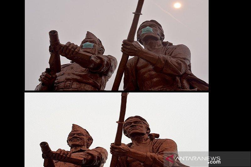 Sebelum Panglima TNI melintas di Monumen Tugu Api, masker di patung dilucuti