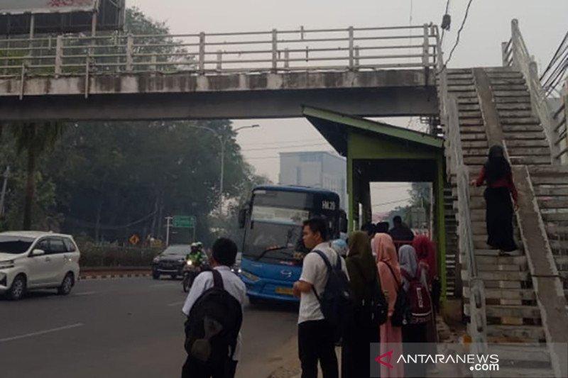 Kota Palembang masih diselimuti asap