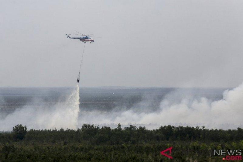 BPBD Sumsel  terjunkan lima helikopter pembom air