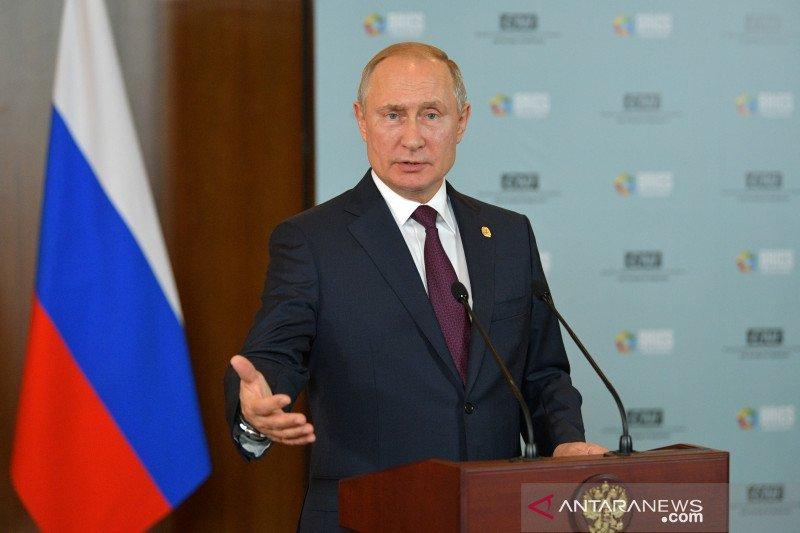 """Putin mengecam larangan terhadap Rusia akibat doping """"bermotif politik"""""""