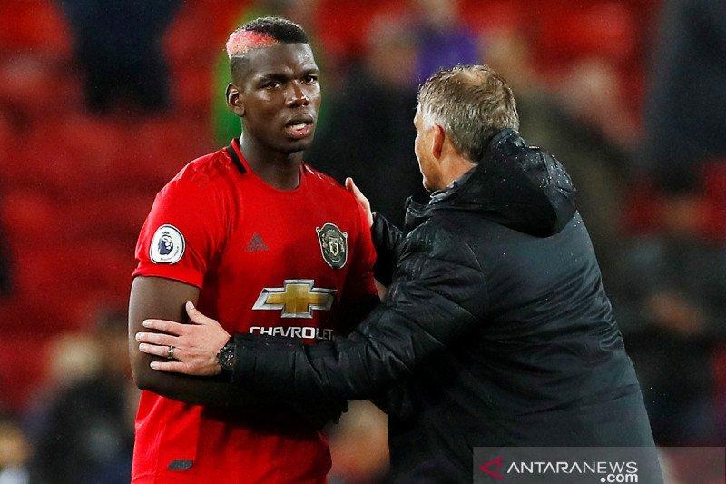 Kembalinya Paul Pogba ke Manchester United harus diundur karena sakit