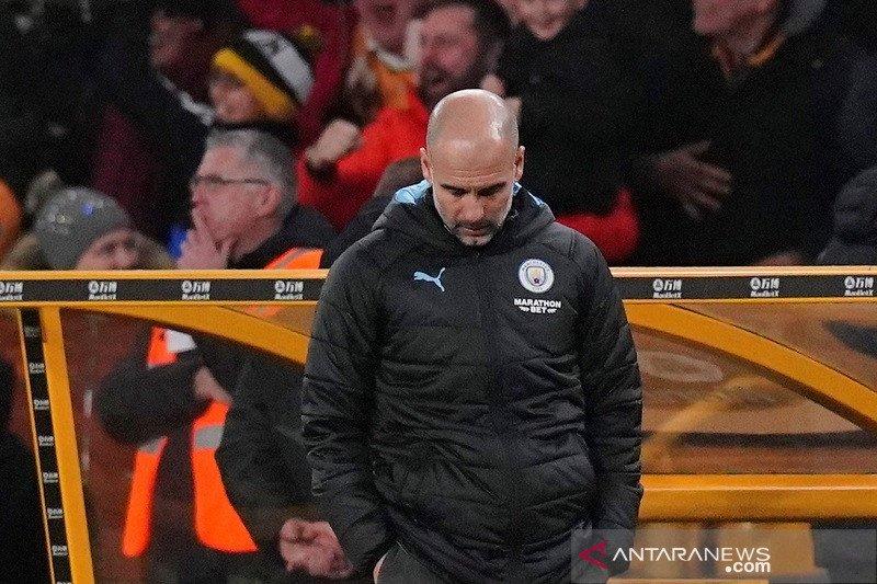 Pep Guardiola mengaku peluang juara Manchester City sudah raib