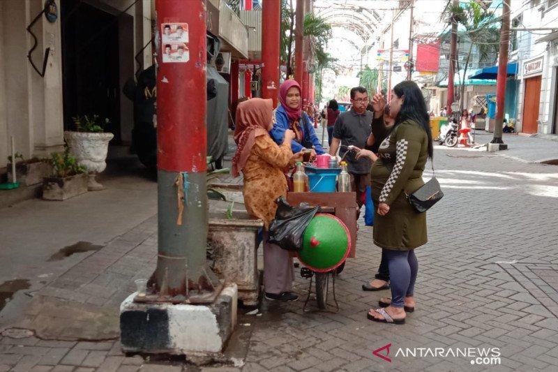 Tangkal corona, penjual jamu keliling promosikan