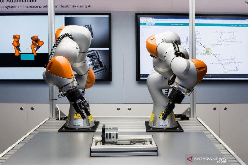 BMW pesan 5.000 unit robot KUKA
