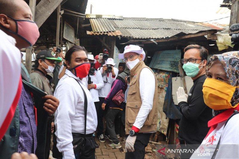 Cairkan suhu politik, relawan Jokowi-Sandiaga bersatu lawan COVID-19