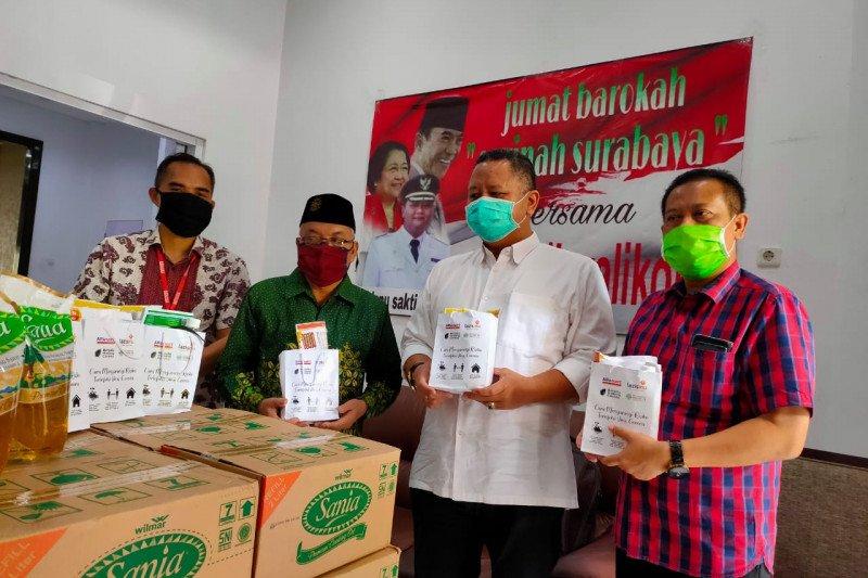 Warga Surabaya kehilangan pekerjaan dapat bantuan ribuan paket dhuafa