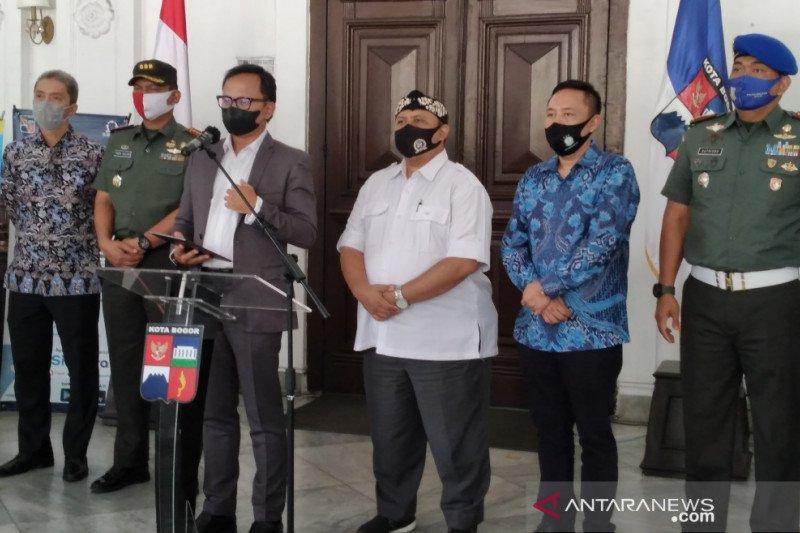 Pemkot Bogor berlakukan PSB mikro dan komunitas selama dua pekan.