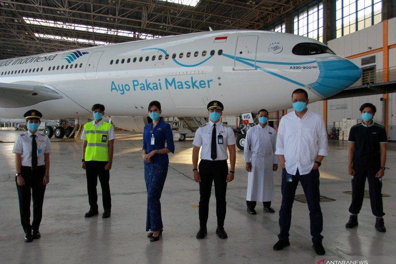 Pesawat Garuda bergambar masker