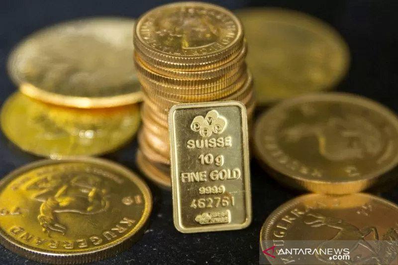 Emas naik tipis terganjal penguatan dolar dan imbal hasil obligasi AS