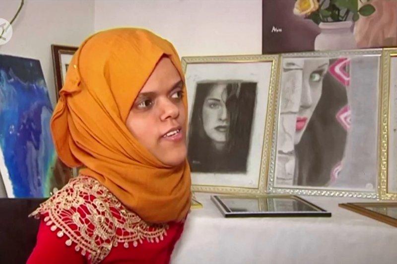 Seorang seniman Yaman yang cacat melukis dunia