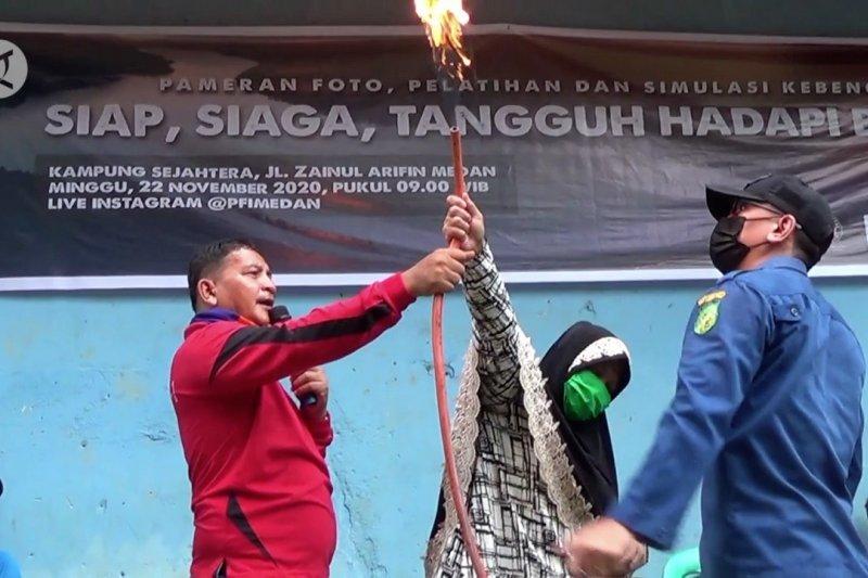 Edukasi tanggap bencana bagi warga kampung Sejahtera di Medan