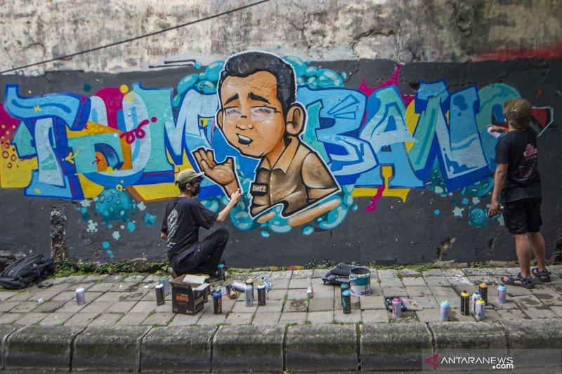 Grafiti  kritik penanganan  COVID-19