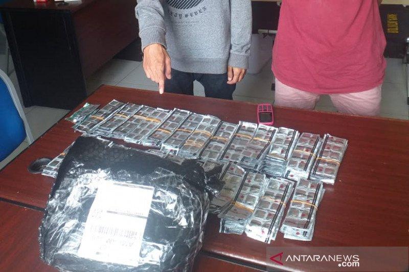 Polda NTB menangkap pengambil paket kiriman 40 ribu butir obat terlarang