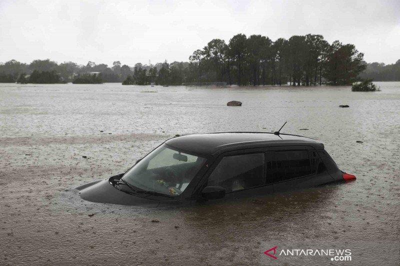 Australia bersiap untuk pemulihan banjir saat cuaca buruk mereda