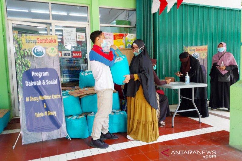 Ramadhan pandemi kedua, AMC bantu sembako guru baca Al Quran